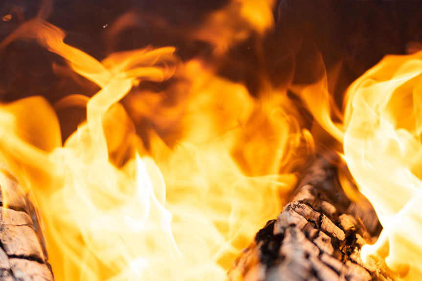 Close up photo of fire in a fireplace